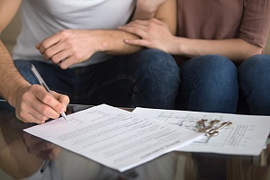 couple signing lease agreement after understanding the landlord tenant law