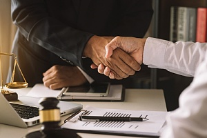 men shaking hands for a business law contract agreement